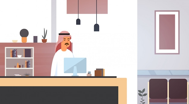Arab business man using computer muslim entrepreneur in modern office Premium Vector