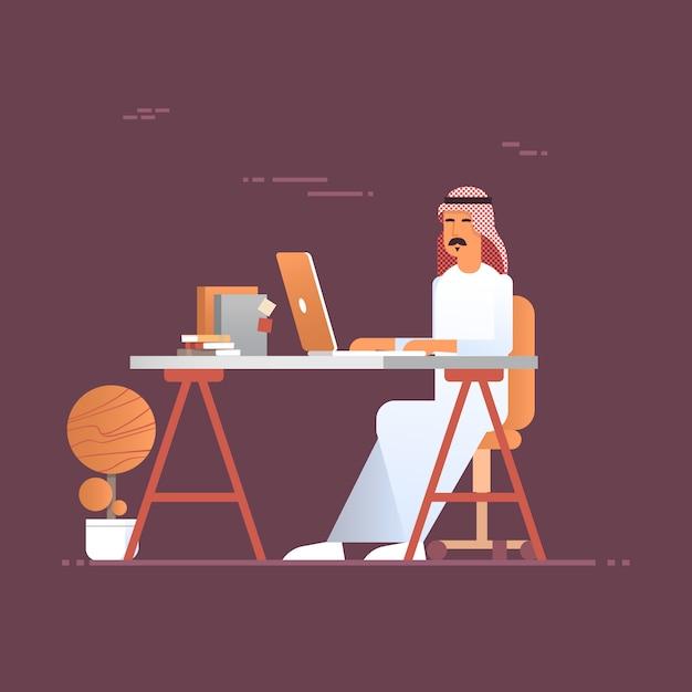 Arab business man using laptop computer muslim entrepreneur in modern office Premium Vector