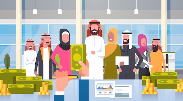 Arab business people group leader giving salary in dollar boss hand hold money businesspeople muslim team Premium Vector