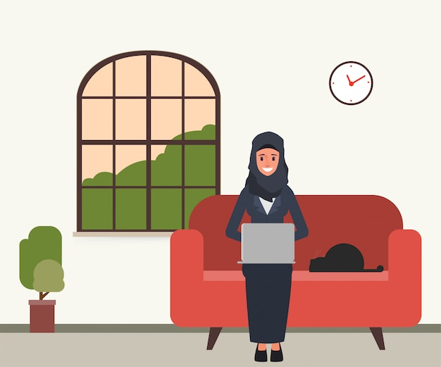 Arab or muslim using a laptop in place. Premium Vector