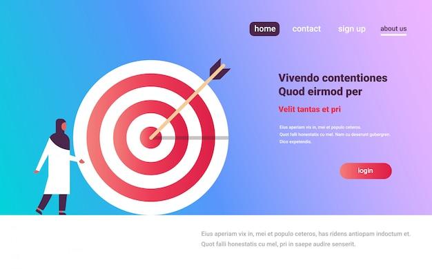 Arab woman standing target arrow goal success business banner Premium Vector