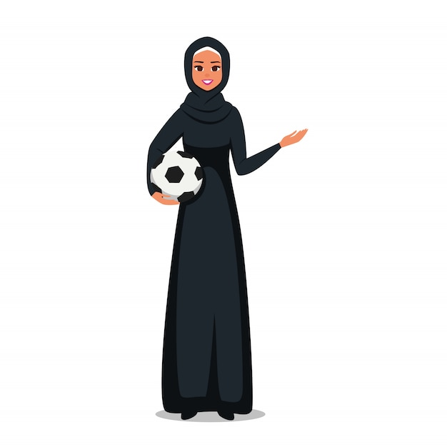 Arab woman wearing hijab holds a soccer ball and showing at something with hand. Premium Vector