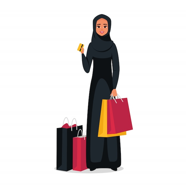 Arab woman with colorful shopping bags holding a credit plastic card. vector Premium Vector