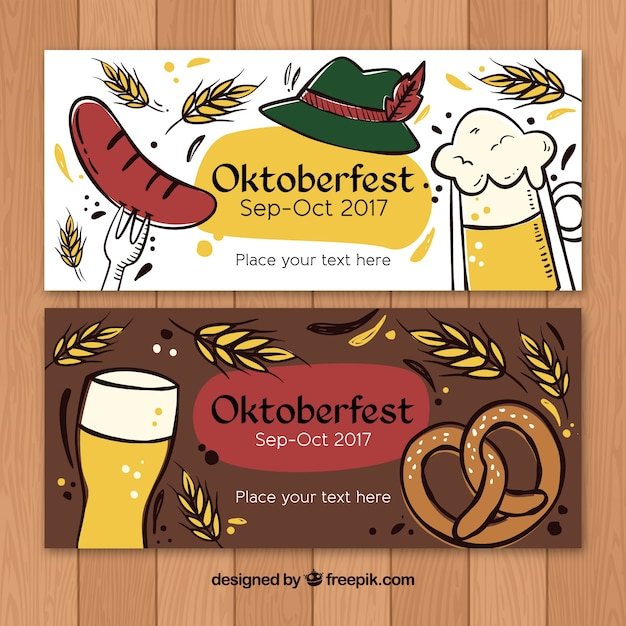 Artistic hand drawn banners for oktoberfest Free Vector