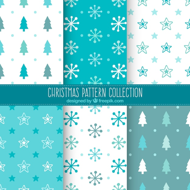 Assortment of blue and white christmas patterns Free Vector