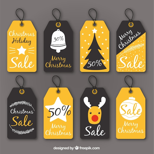 Assortment of discount vintage christmas labels Free Vector
