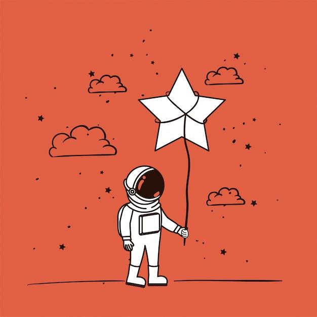 L'astronauta disegna con la stella Vettore gratuito