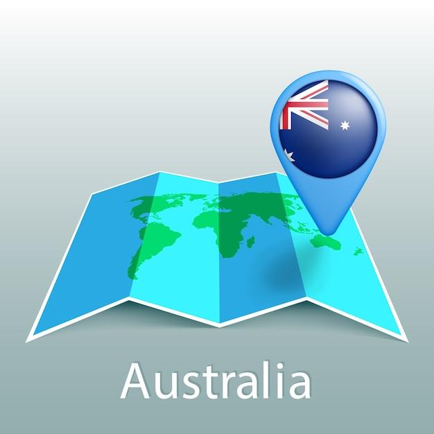 灰色の背景に国の名前とピンでオーストラリアの旗の世界地図 Premiumベクター