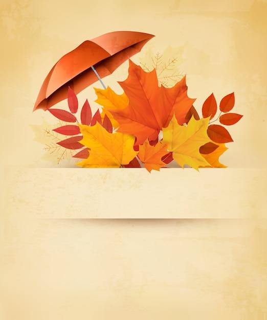 Autumn background with autumn leaves and red umbrella. Premium Vector