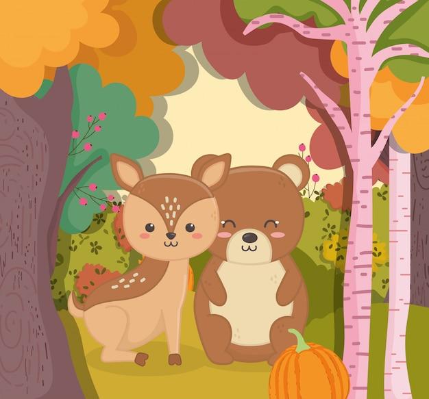 Осенние иллюстрации милый медведь и олень с тыквенным лесом Premium векторы