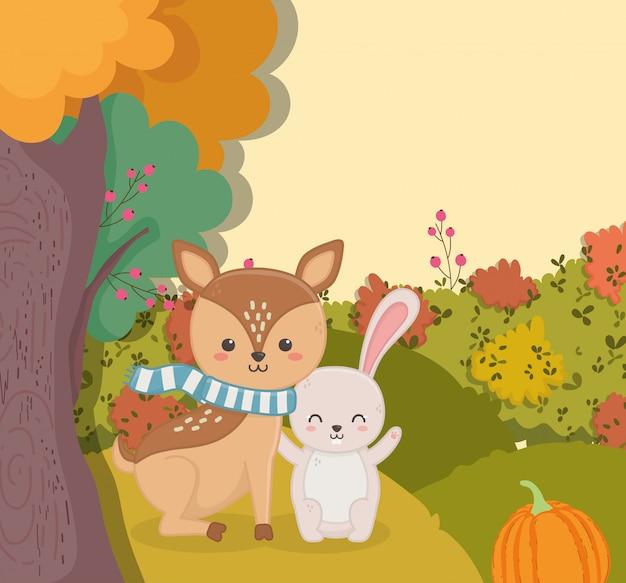 Осенние иллюстрации милый олень с кроличьим тыквенным лесом Premium векторы