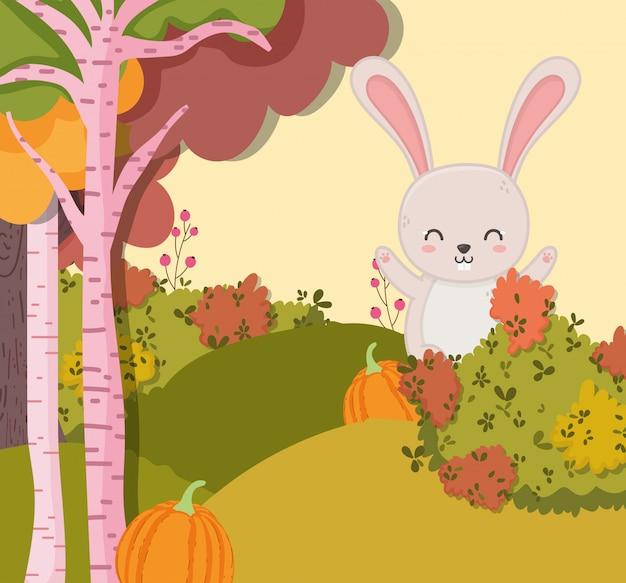 Осенняя иллюстрация улыбающегося кролика с тыквенным лесом Premium векторы