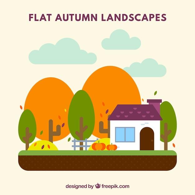 Autumn landscape with house and pumpkins