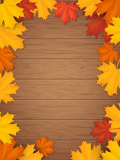 木製の背景に紅葉。落ちたカエデの葉からのフレーム。 Premiumベクター