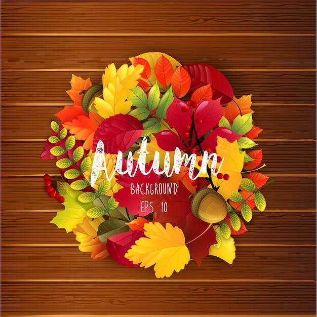 Autumn leaves on wood background Premium Vector