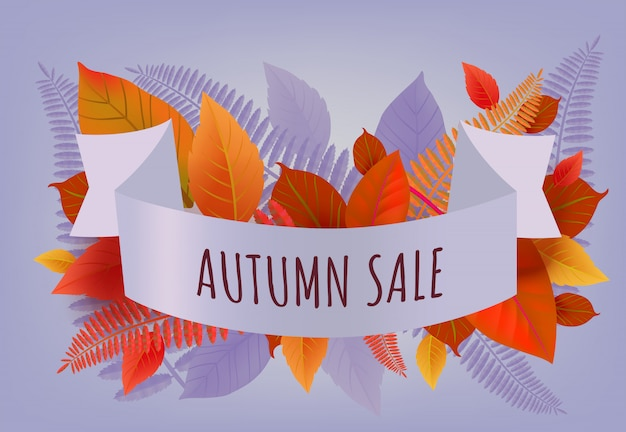 Autumn sale lettering with orange and purple\ leaves. Autumn offer or sale advertising