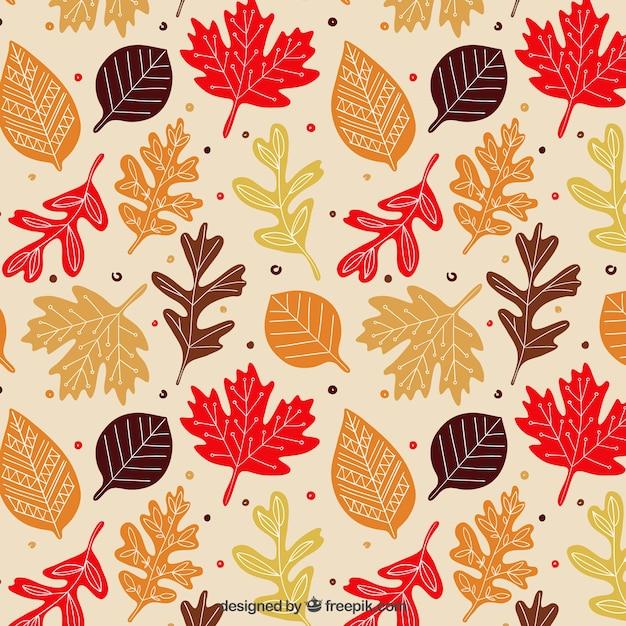 Autumnal leaves pattern Premium Vector