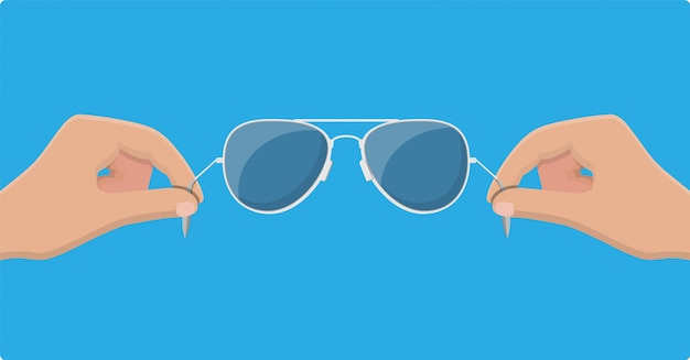 Aviator sunglasses in hand. protective eyewear. Premium Vector