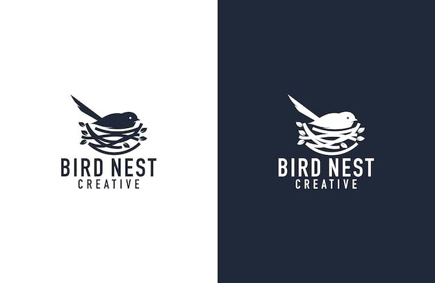 素晴らしい鳥と巣のロゴの図 Premiumベクター