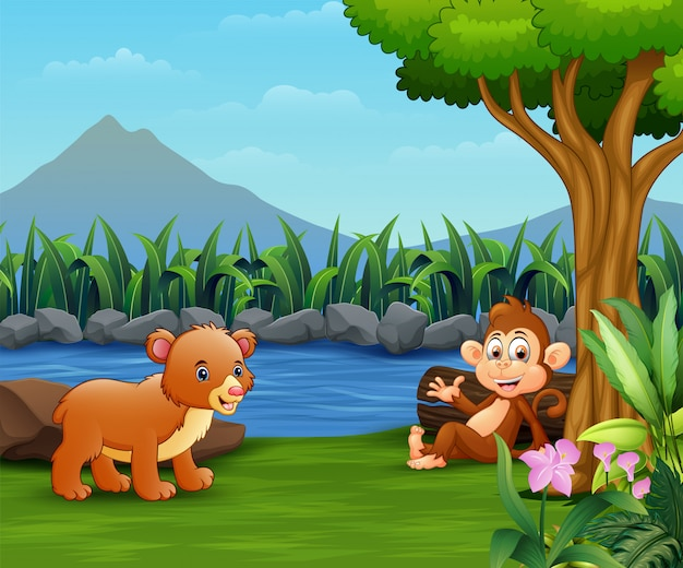 Baby bear and monkey enjoy by the river Premium Vector