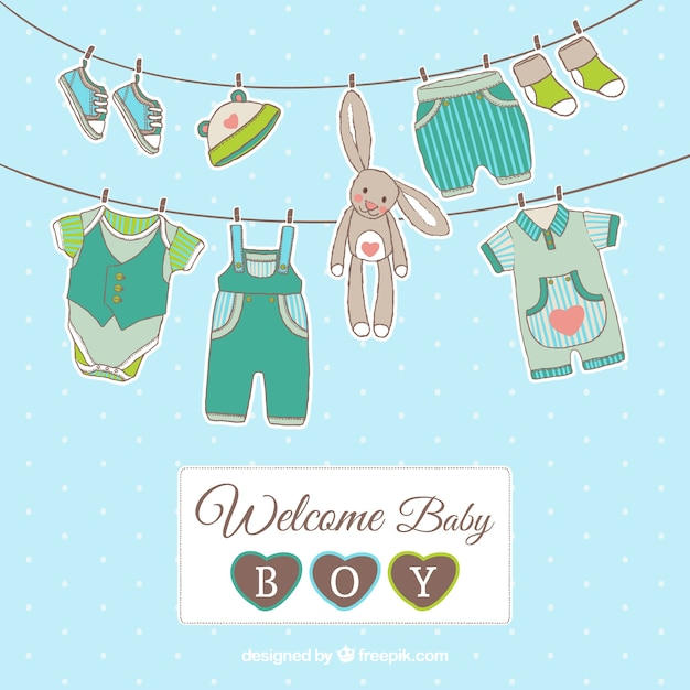 Baby boy card with hanging clothes