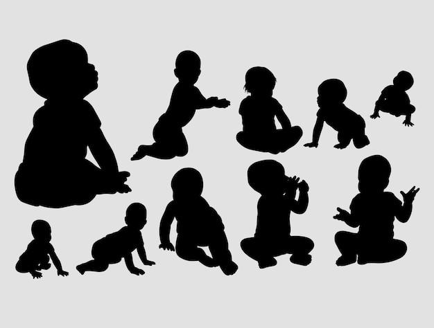 赤ちゃんの遊びとクロールのシルエット Premiumベクター