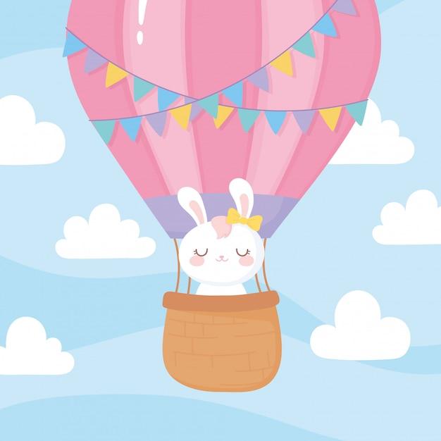 Детский душ, летающий милый кролик в небе на воздушном шаре Premium векторы