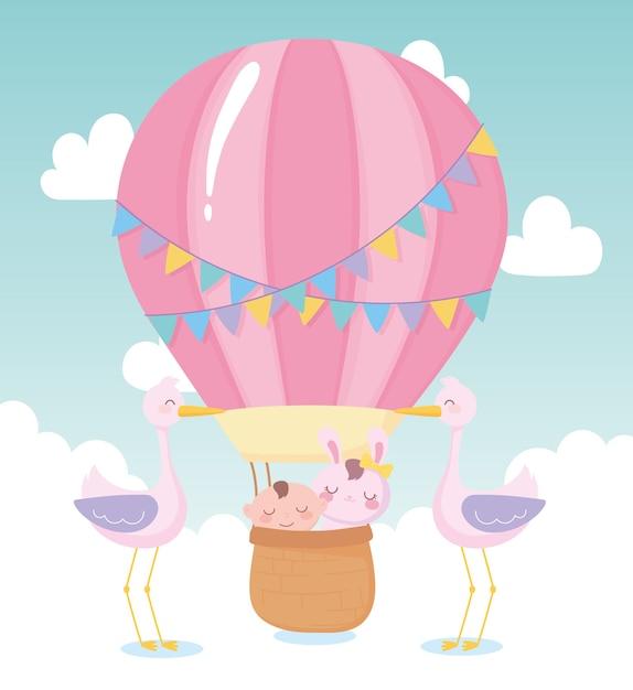 Baby shower, little boy and rabbit in basket storks, celebration welcome newborn Premium Vector