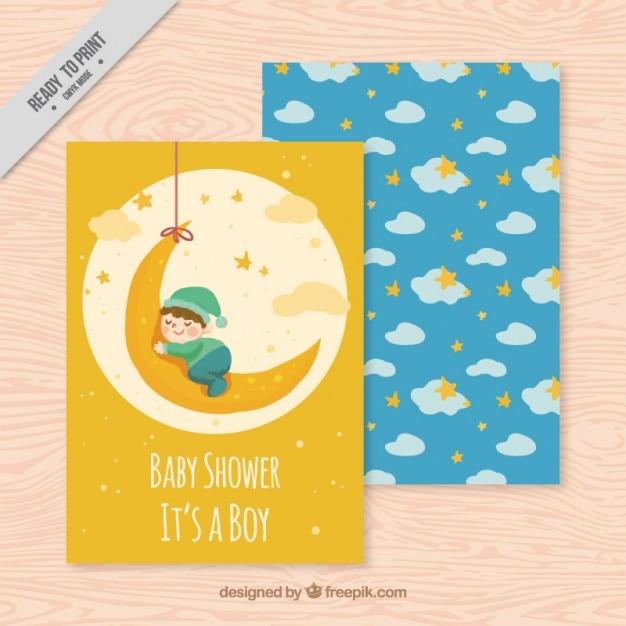 Baby sleeping in the moon card Free Vector