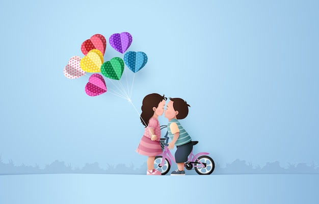 Babygirl and babyboy kissing Premium Vector