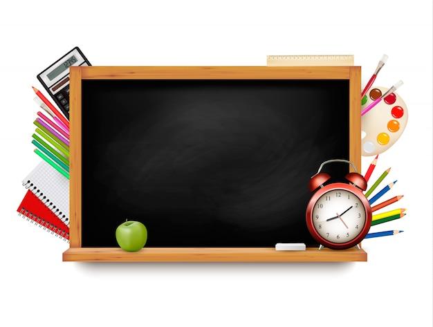 Back to school. blackboard with school supplies. Premium Vector
