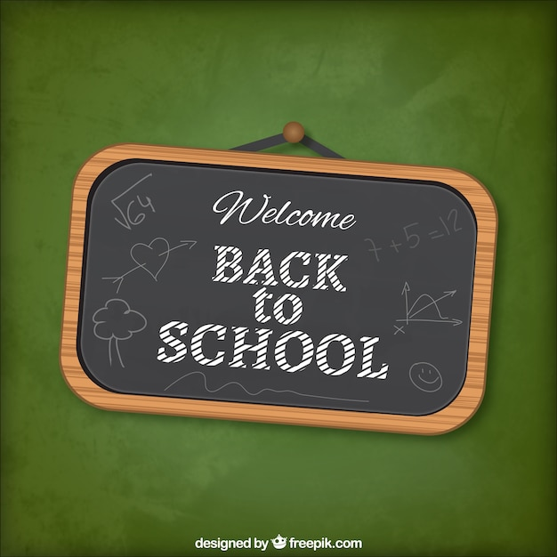 Back to school lettering on blackboard Free Vector