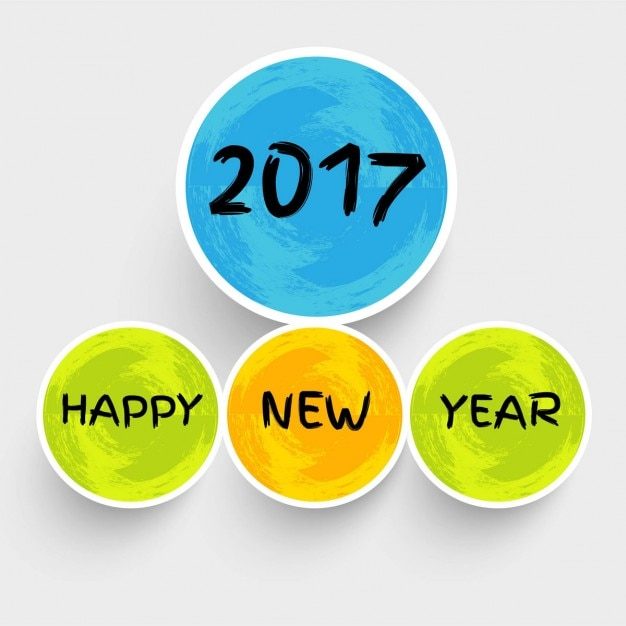 Background of happy new year 2017 with colored circles Free Vector