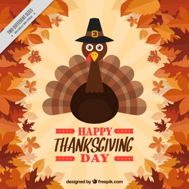 Background of leaves with nice thanksgiving turkey Free Vector