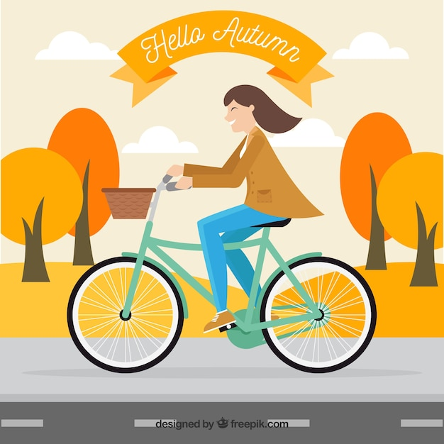 Background of woman on a bicycle in an autumnal\ landscape
