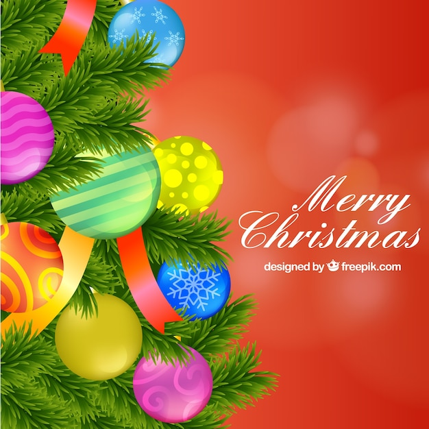 Background with baubles on a christmas tree Free Vector