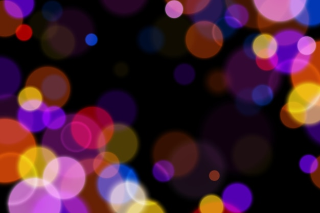 Background with bokeh effect in the dark Free Vector