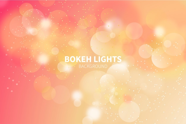Background with golden bokeh lights Free Vector