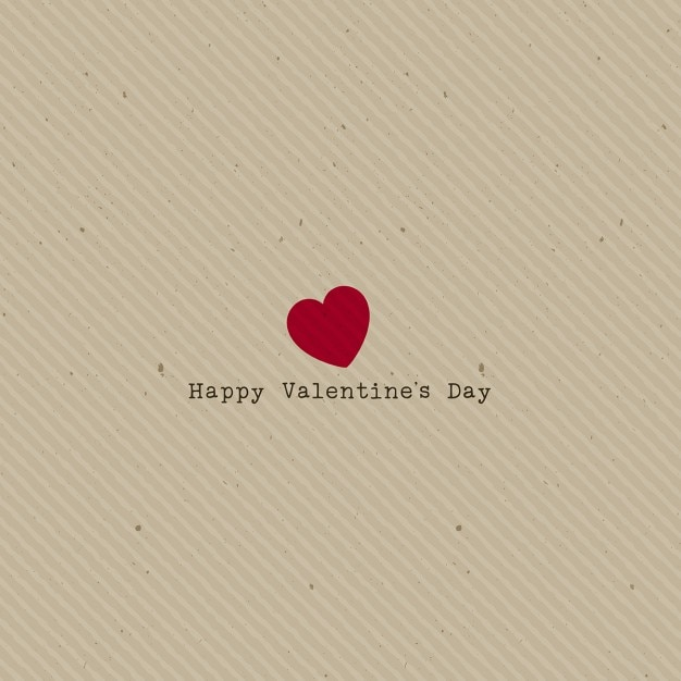 Background with a heart on a paper texture Free Vector