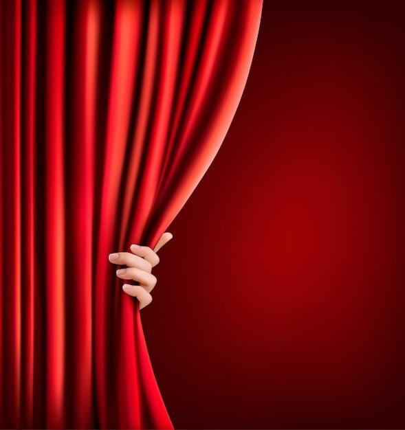 赤いベルベットのカーテンと手で背景 Premiumベクター