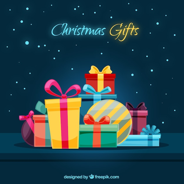 Background with variety of christmas  gifts Free Vector