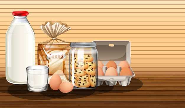 Baked goods with bottle of milk and two eggs in a group Free Vector