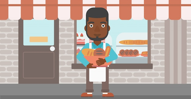 Baker holding basket with bakery products. Premium Vector