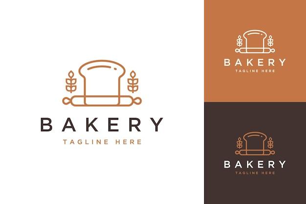 베이커리 디자인 로고 또는 그라인더와 밀 빵 프리미엄 벡터
