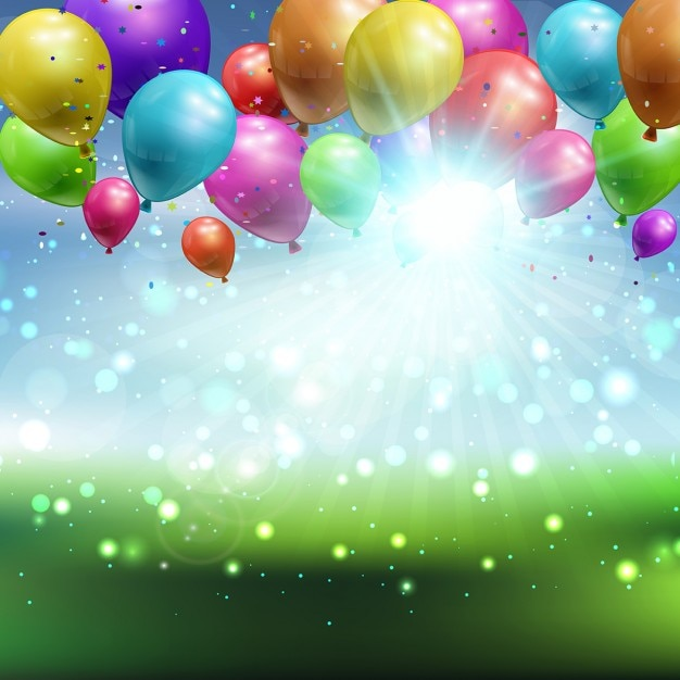 Balloons and confetti on a defocussed landscape background Free Vector