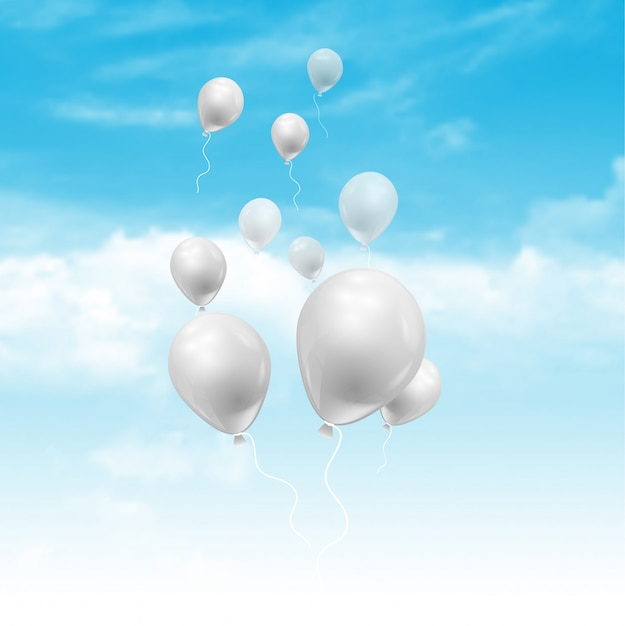Balloons floating in a blue sky with fluffy\ white clouds