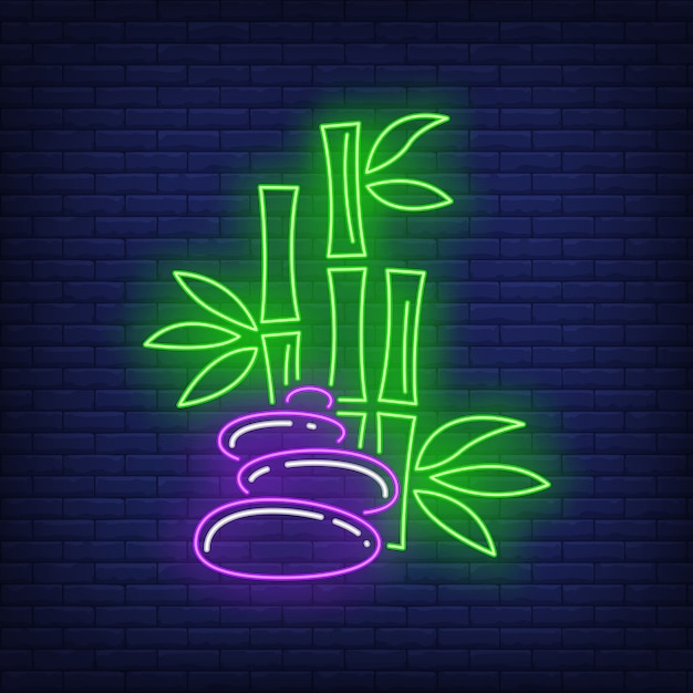 Bamboo and stones neon sign Free Vector
