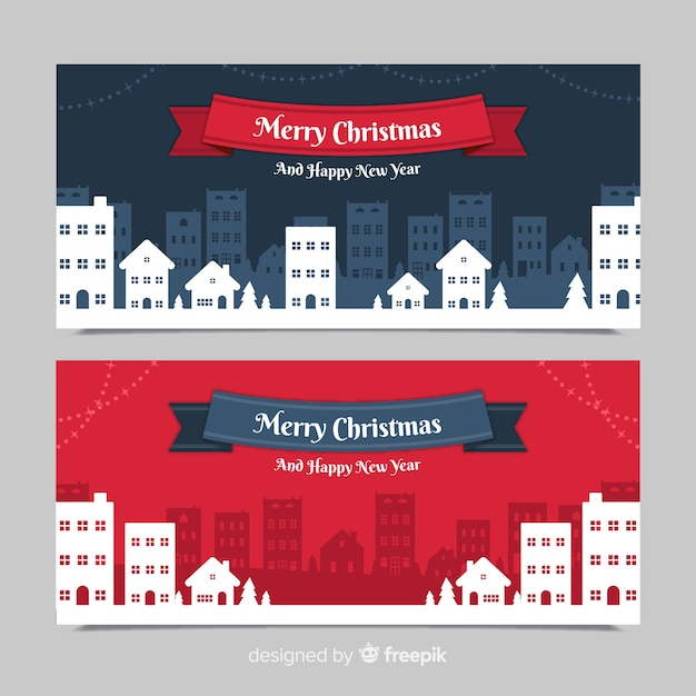 Banners in flat design with christmas town Free Vector
