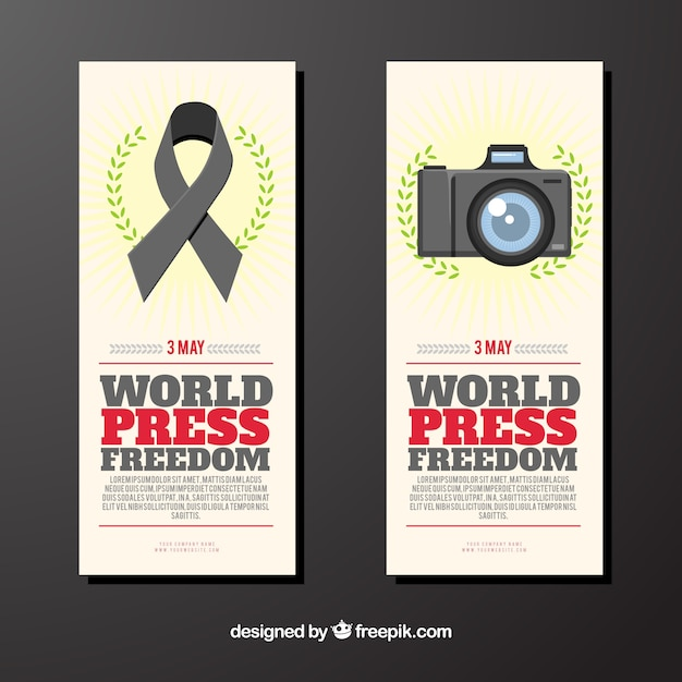 Banners with ribbon and photo camera of world press freedom day