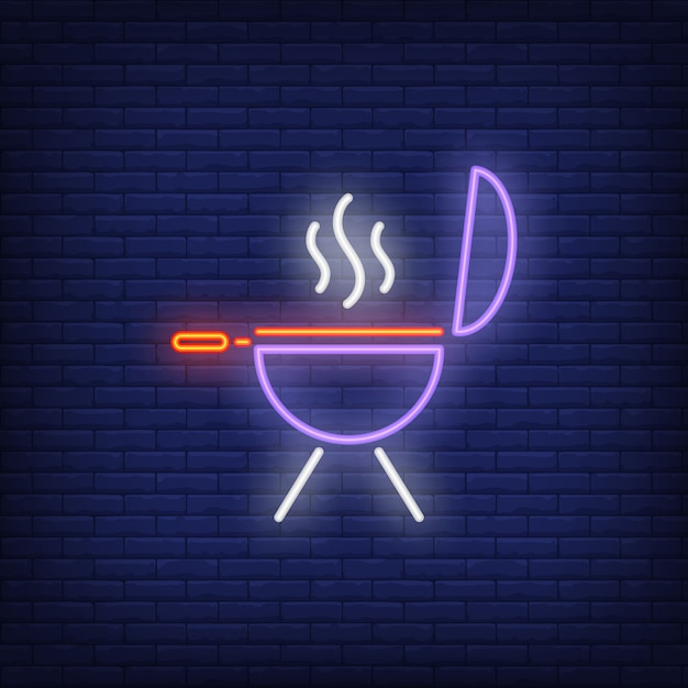 Barbeque grill on brick background. neon style illustration. Free Vector